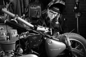 jessi combs working on motorcycle